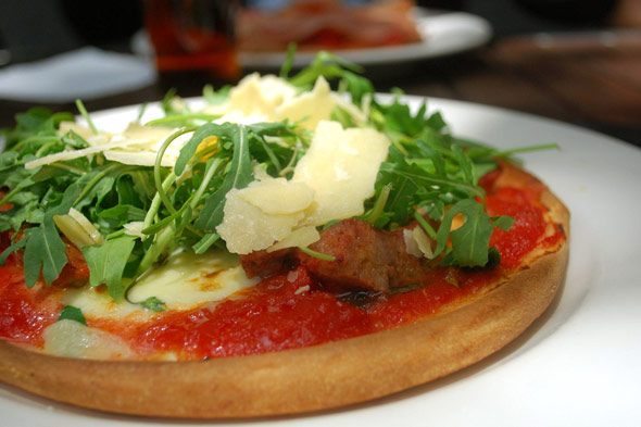sausage and arugula pizza with Fior di Latte cheese