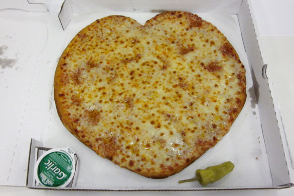 Papa John's Pizza is offering lovers a thin-crust heart-shaped pizza for