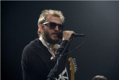 Justin Vernon performs with Gayngs