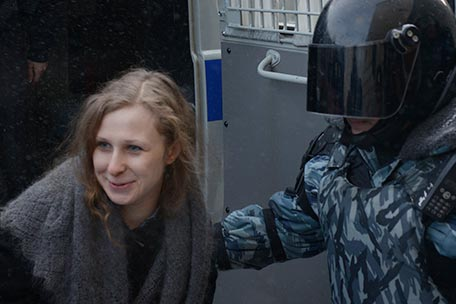  Jailed feminist punk band Pussy Riot member Maria Alekhina, center, is escorted to a court room