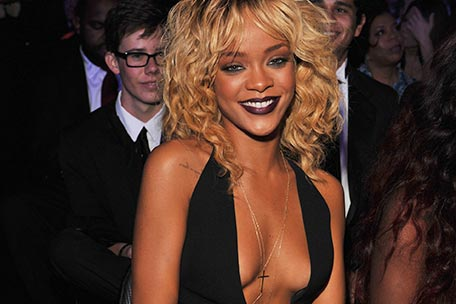Rihanna showing off sideboob and a bit of underboob at the Grammys