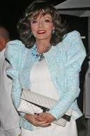 joan-collins-wearing-shoulder-pad-jacket