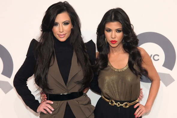 kim kardashian 2011 outfits. Kourtney and Kim Kardashian on