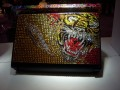 Picking just one thing from the Ed Hardy booth was tough, but we eventually settled on this retina-searing collection of
