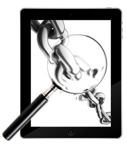 magnifying glass and ipad
