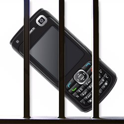 a cell phone behind bars