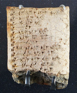 a tablet with ugaritic script