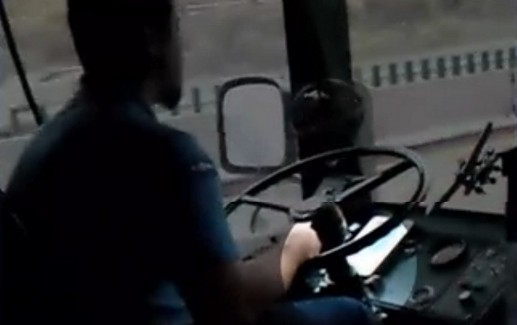 Bus Driver Reading While Driving