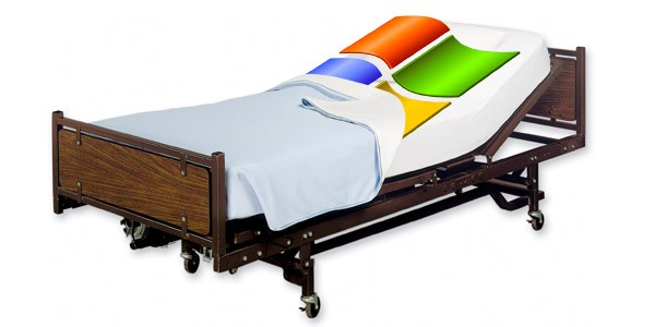 xp logo in hospital bed