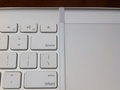 Join line between the keyboard and trackpad