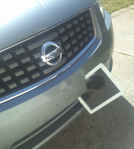 iPad flies off of car roof, wedges itself into another car's bumper