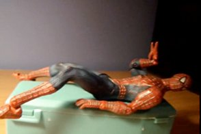 Spider-Man figurine lying prone