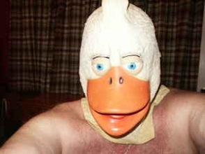 man in scary duck mask