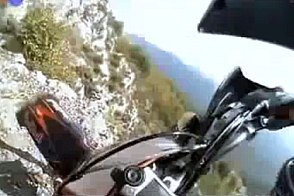 dirt biking on a cliff
