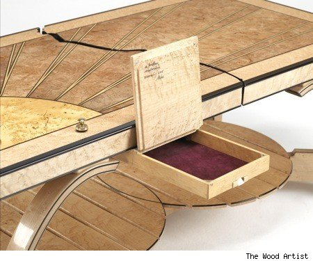 A Nice Suede Lined Compartment In A Coffee Table.