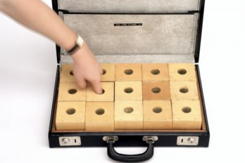 finger poking boxes with holes in suitcase