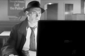 detective using laptop in hardboiled foursquare film noir