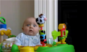 baby scared and laughing at mom blowing nose
