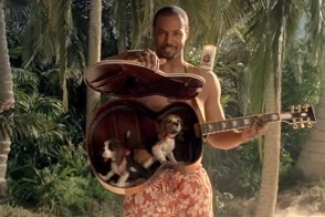old spice guy fiji ad starring isaiah mustafa, a guitar, and puppies