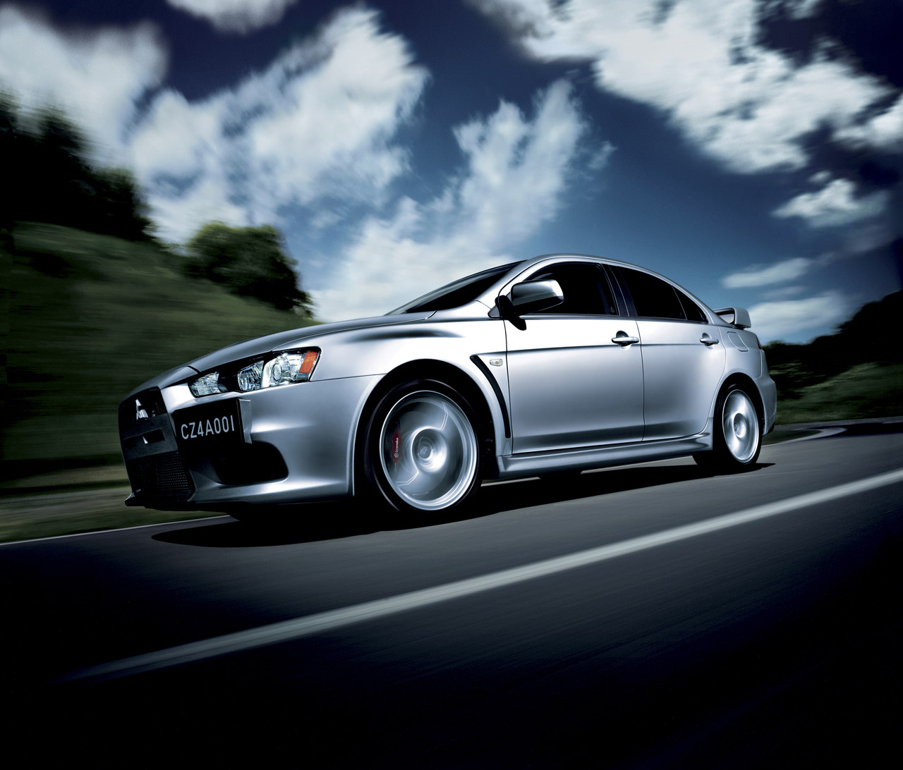 Mitsubishi Background: 2011 Mitsubishi Lancer Evolution Wallpaper CAR DESIGNS