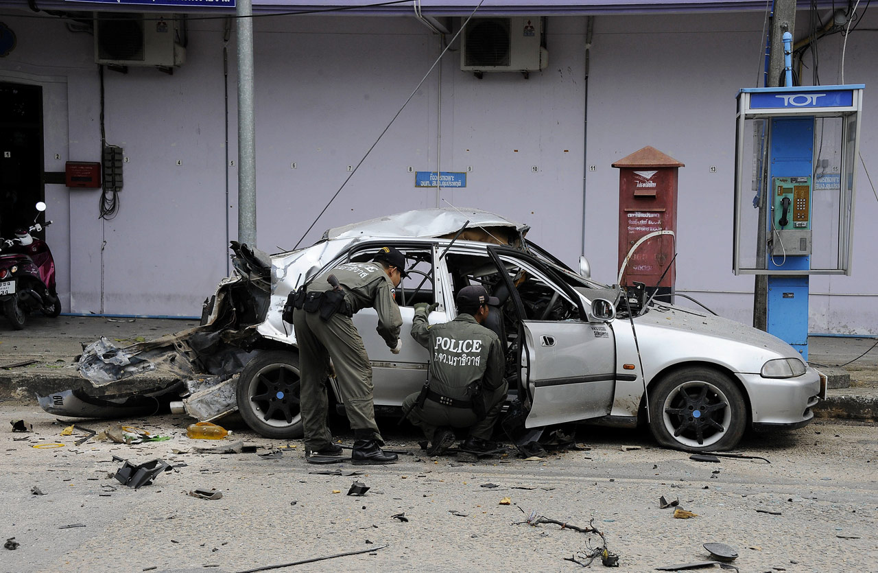 Thai Car Ripped Apart By Explosion As Bomb Expert Inspects