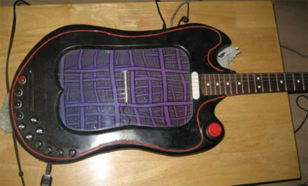 Guitar modded to integrate laptop with music visualizer