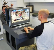 A custom PS3 arcade cabinet? Sign us up!